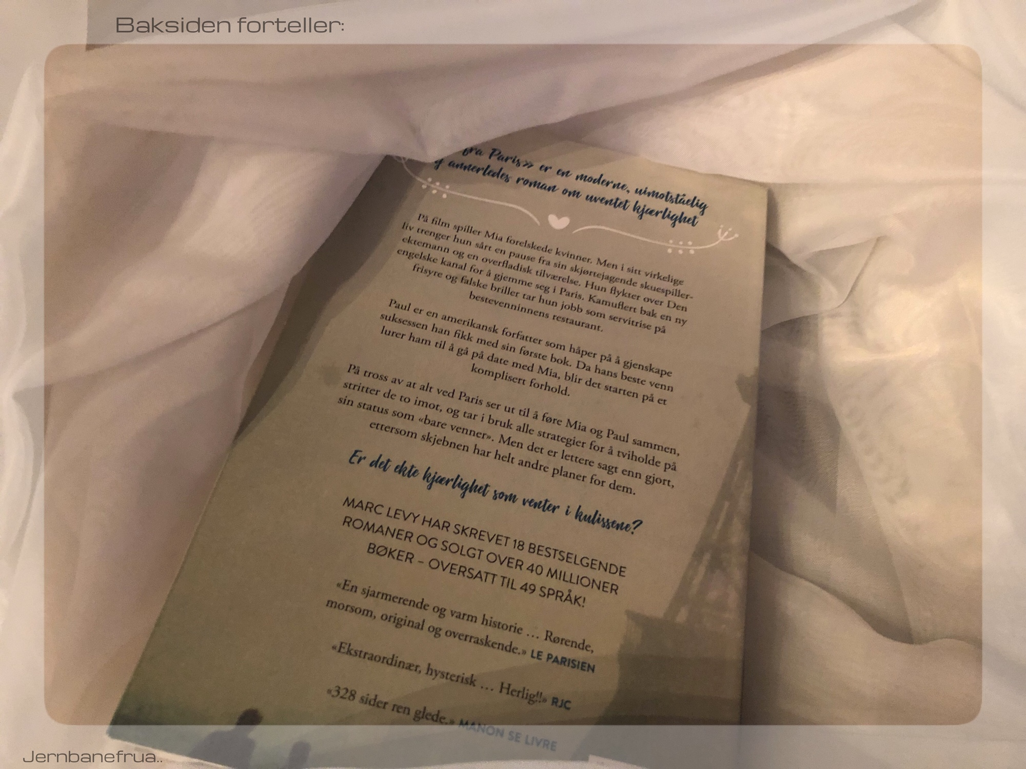Jernbanefrua deler baksiden av boken PS fra Paris..
