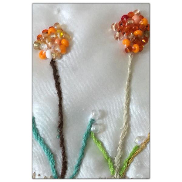 De herlige orange blomstene
