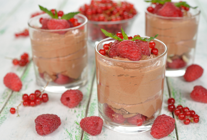 Chocolate mousse with raspberries on a white background