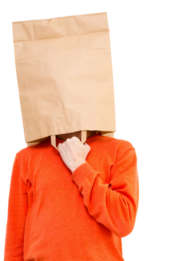 Man in paper bag on head showing with forefingers isolated on white background.