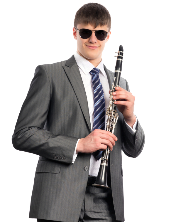 Young musician plays the clarinet on a white background