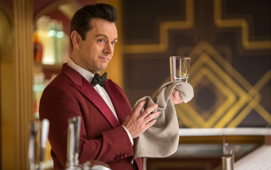 Bartender Arthur (MICHAEL SHEEN) behind the Grand Concourse Bar in Columbia Pictures' PASSENGERS.