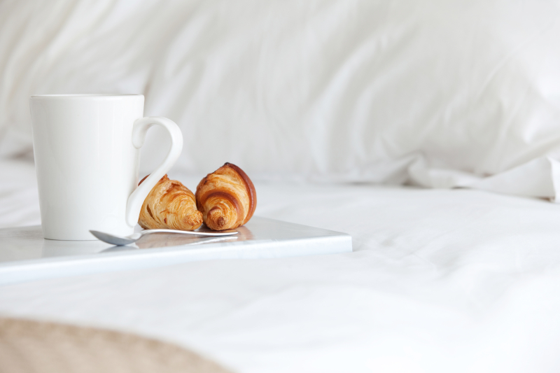 Tray with breakfast on a bed