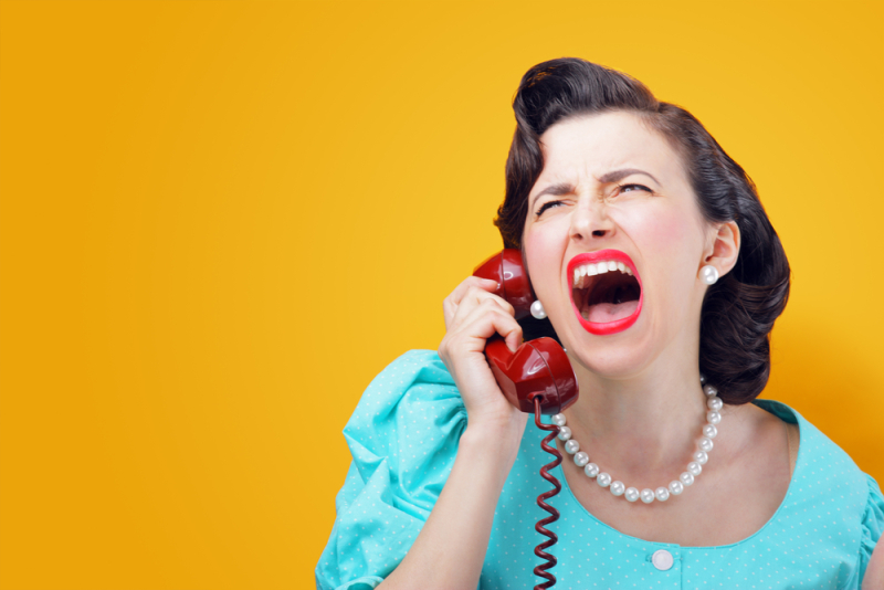 Vintage Woman shouting into telephone