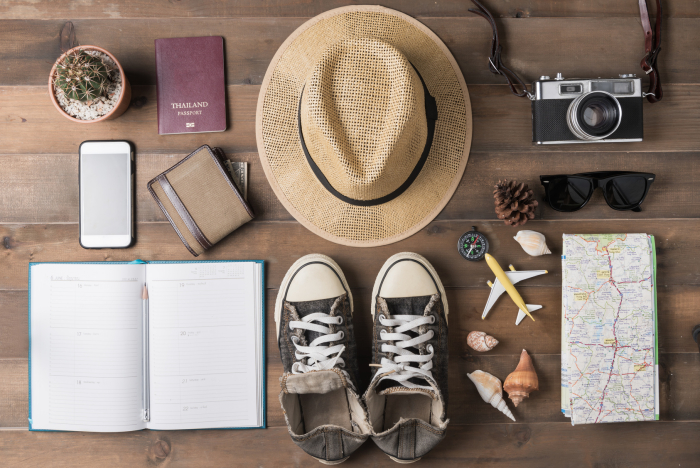Travel plan, trip vacation, tourism mockup - Outfit of traveler on wooden background. Flat lay.