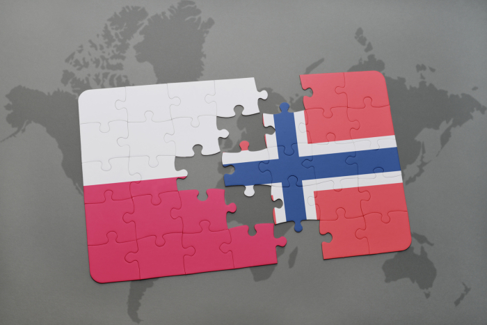 puzzle with the national flag of poland and norway on a world map background. 3D illustration