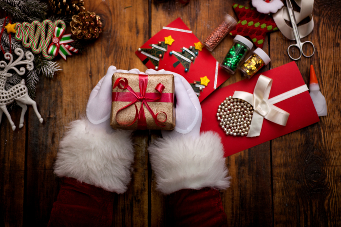 Merry Christmas and Happy Holidays! woman prepare Xmas gifts